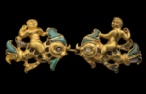 Cat. No. 80: Pair of clasps depicting Cupids on dolphins (Tillya Tepe, Tomb III, 1st century BC -1st century AD, gold, turquoise and mother-of-pearl, dim. of left clasp: 4.2 x 5.2 x 7 cm (1 5/8 x 2 1/16 x 1/4); dim. of right clasp: 4.1 x 5.6 x 7 cm (1 5/8 x 2 3/16 x 1/4) - National Museum of Afghanistan © Thierry Ollivier / Musée Guimet