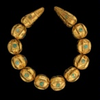 Cat. No. 143: Necklace (Tillya Tepe, Tomb VI), 1st century BC - 1st century AD, gold and turquoise, length of long bead: 5 cm(2); diameter of long bead: 2.2 cm (7/8); length of round bead: 2.7 cm (1 1/ 16);  diameter of round bead: 2.6 cm (1)  - National Museum of Afghanistan © Thierry Ollivier / Musée Guimet