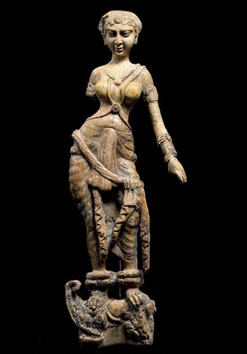 Fig. 13: Cat. No. 148 Statuette of a woman standing on a  makara, possibly a furniture ornament (Begram, Room 10), 1st - 2nd centuries AD (ivory, 45.6 cm (17 15/ 16)) - National Museum of Afghanistan © Thierry Ollivier / Musée Guimet